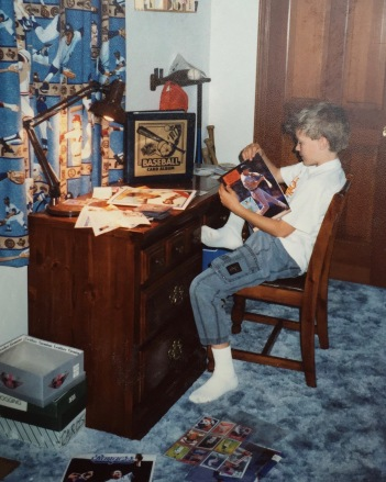 Ancient photo of Chris obsessing over his baseball card collection