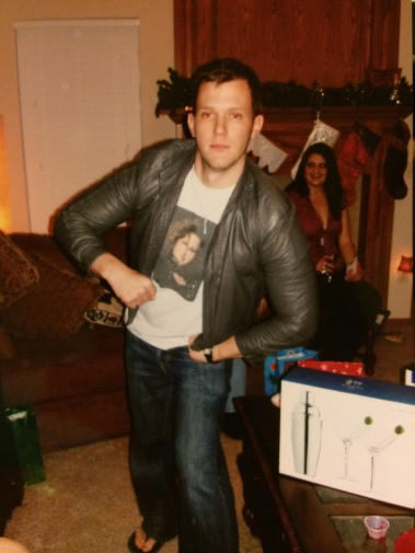 Here I am all grown up wearing a photo of my wife's 80s glamor shot. Also wearing a very tight leather jacket some hipster wore to our Christmas party that year. Also, I'm drunk in this photo.