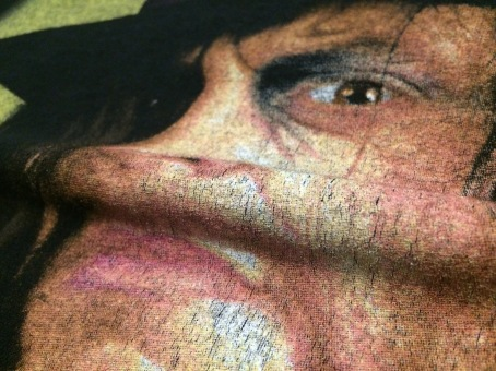 Notice the small cracks appearing when I gently pull on either side of the Undertakers face...